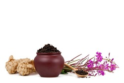 Clay pot with dry tea, bast shoes and blooming Chamerion angustifolium (common names: fireweed, great willowherb, rosebay willowherb) isolated on a white background. Russian traditional herbal tea.