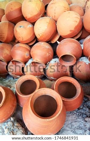 clay pots are arranged in Potter's pot burning chimney after burning for sale. soil made pots are isolated after making. front and back of the pot. Clay pot, Terracotta art, terracotta pots making