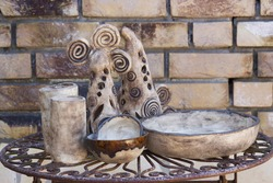 clay pots on a metal table - handmade pottery