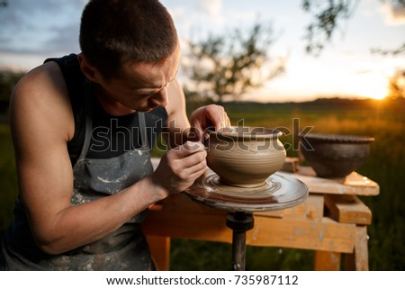 clay potter creating on the...