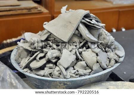 clay scraps in a bowl in a...