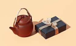 Clay teapot and gift box. Minimal present holiday birthday chris