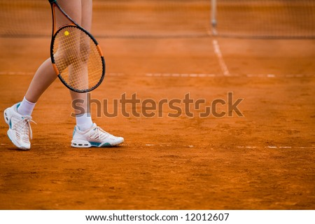 Clay tennis court with Tennis player legs