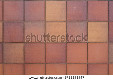 Clay Tile Flooring texture. Clay tiles. Red stone clay quarry tiled floor detail. Aged tiles square clay orange floor. tiled floor with Terracotta tiles