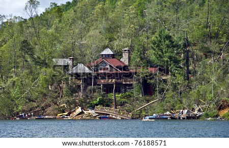 CLAYTON, GA, -  APRIL 28:  Debris and damage from recent tornado storms is seen in the Lake Burton area on April 28, 2011 in Rabun County, Clayton, GA.  This house was spared while the area on the lake was demolished.