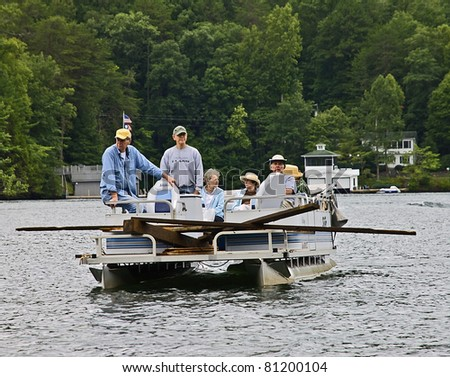 CLAYTON, GA /USA - JULY 16:  Cleaning up debris July 16, 2011 in Lake Burton, Clayton, GA.  A powerful tornado hit the area on April 27, 2011 and residents are still working to clean out the lake. - stock photo
