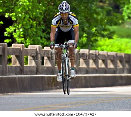 CLAYTON, GA/USA - JUNE 9 : Unidentified cyclist participates in the annual Bicycle Ride Across Georgia, June 9, 2012, in the Lake Burton area of Rabun County, Clayton, GA.