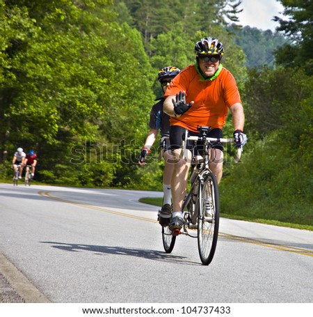 CLAYTON, GA/USA - JUNE 9 : Unidentified cyclist participates in the annual Bicycle Ride Across Georgia, June 9, 2012, in the Lake Burton area of Rabun County, Clayton, GA.