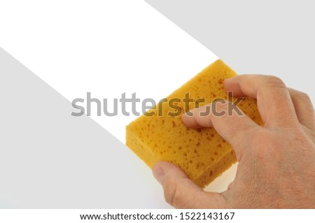 Clean a surface with a sponge #1522143167