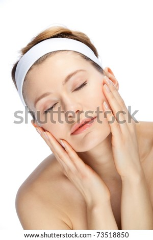 clean and beautiful face of a young woman - stock photo
