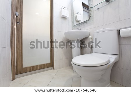Clean and white water closet in a bathroom