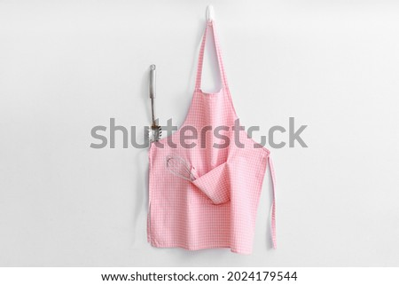 Clean apron and kitchen utensils on white background Foto stock ©