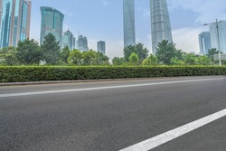 clean asphalt road with city skyline background,shanghai,china.