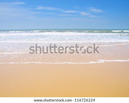 Clean beach with blue sky