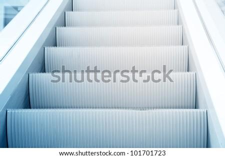 Clean beautiful blue escalator way up concept
