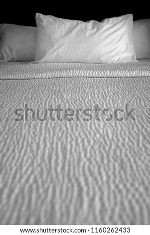 Clean bed bedding and pillows with white sheets for comfort sleeping #1160262433