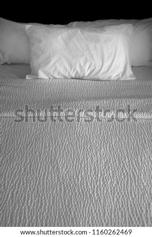 Clean bed bedding and pillows with white sheets for comfort sleeping #1160262469