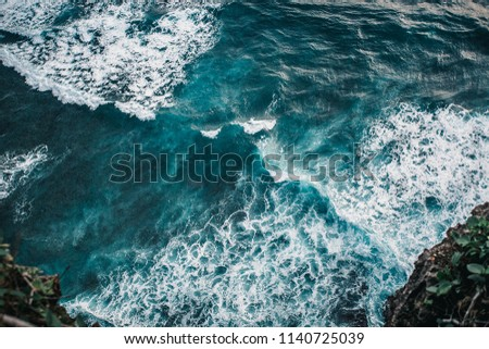 clean blue ocean water surface with waves and foam. top view from drone. aerial photography #1140725039