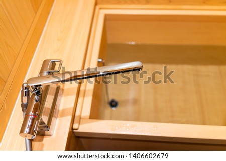 Clean cypress bathtub wooden traditional Japanese tub with water in home house or onsen hotel bathroom interior with nobody and in Japan