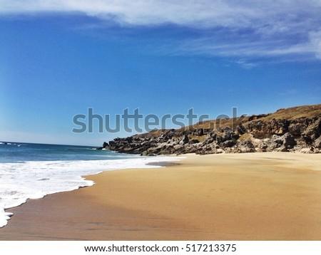 Shutterstock clean deserted beach in Puerto Escondido, Mexico