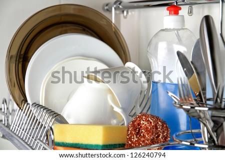 clean dish-ware, detergent and sponge