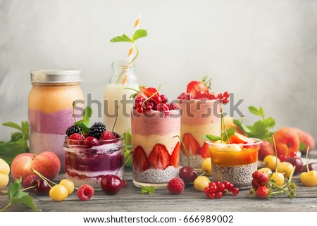 Clean eating ideas for breakfast or snack. Assortment of  berry fruit  smoothies, juices and chia seeds pudding . Concept of healthy eating.