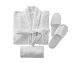 Clean folded bathrobe, slippers and towel isolated on white, top view