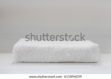 Clean folded towel #615896039