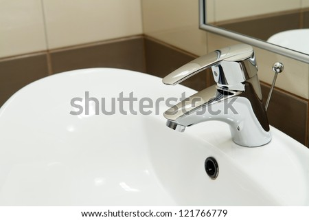 clean hotel bathroom sink and faucet