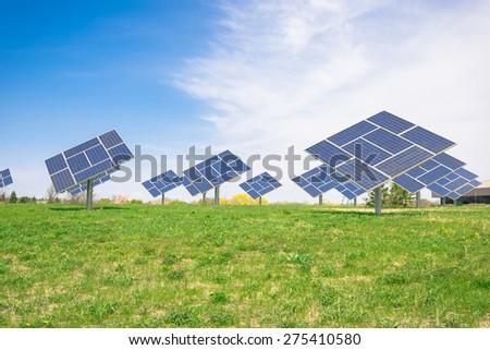 Clean image of commercial Solar plant on a prairie generating clean electric power