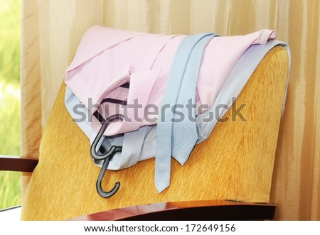 clean ironed shirt hanging on a chair