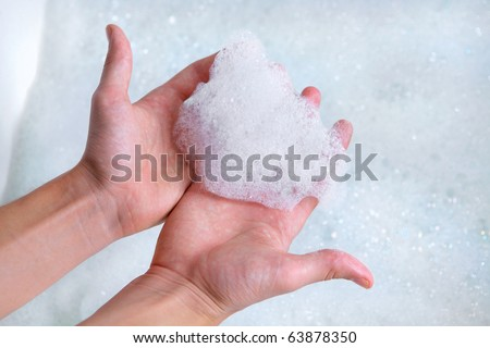 clean male hands washing with soap foam bubbles