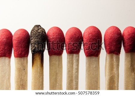 Clean matches around a burnt one.