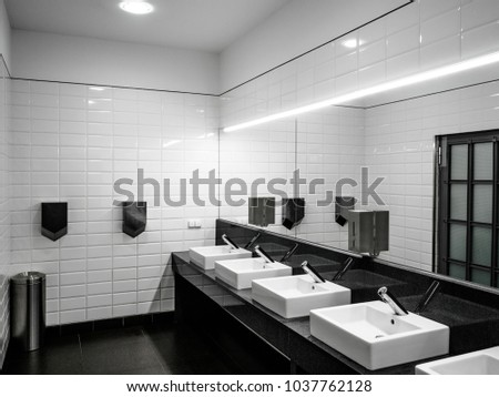 . An Modern Public Bathroom in window light   Free Images and Photos