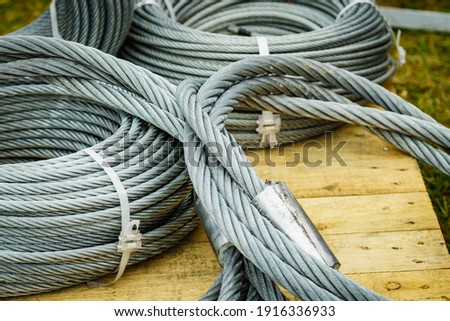 Clean new steel rope wire, coiled steel cable. Industrial equipment Foto d'archivio ©