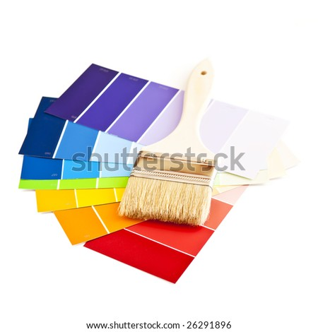 Clean paintbrush on rainbow of color card samples