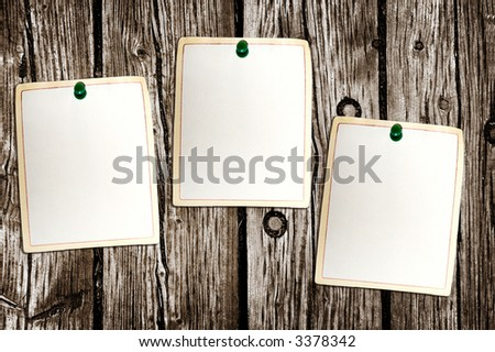 Clean paper sheets attached to the wooden background
