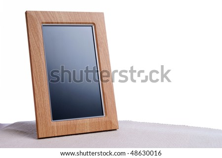 clean photoframe on the table in white background