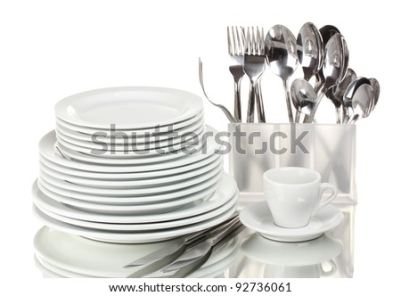 Clean plates and cutlery isolated on white