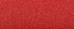 Clean red leather fullframe texture. Empty red leatherette closeup macro background.