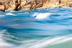 Clean River Water Flowing Fast. Choppy Flowing Rapids. Splashing, Sea / Ocean, Liquid Flow. Long Exposure Photography.