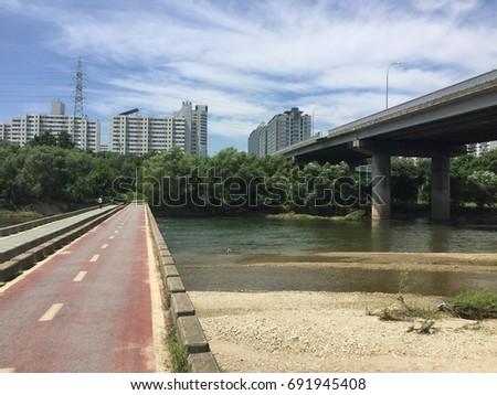 Clean river water under the bridge #691945408