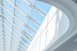 Clean roof windows and blue sky. Element of a modern glass roof of a shopping mall or airport, abstract image