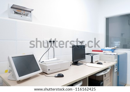 clean room with table and boxes for equipment - stock photo