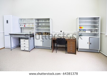 clean room with table and boxes for equipment