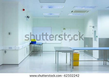 clean room with tables in medical packaging plant interior