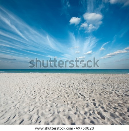 Clean sand beach and blue sky Caribbean Sea. Riviera Maya, Mexico