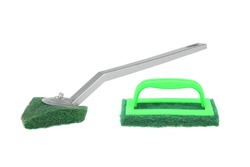 Clean scrubber isolated on white background, green fiber scourer with plastic handle with clipping path