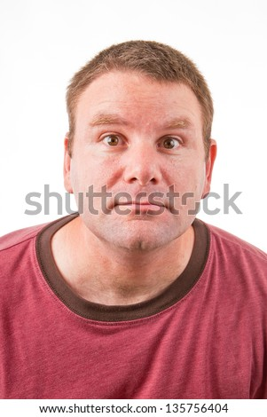 Clean shaven Caucasian male leaning forward and making a weird or funny face