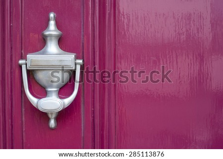 Clean silver knocker on pink background. - Shutterstock ID 285113876
